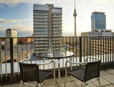 Enjoy stunning city views from our Suite Balcony