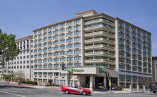 Exterior night shot of hotel from Massachusetts Avenue, NW