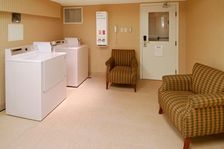 Spacious and well lit laundry room , almost makes laundry fun!!